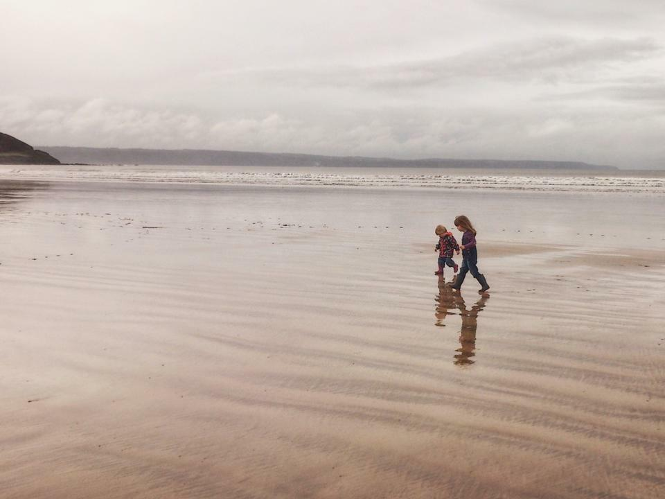 Two kids walking at the beach