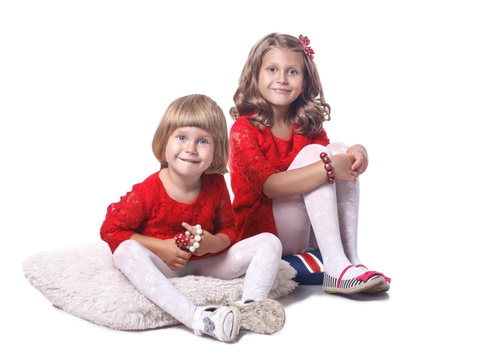 Two little girls sitting on the floor