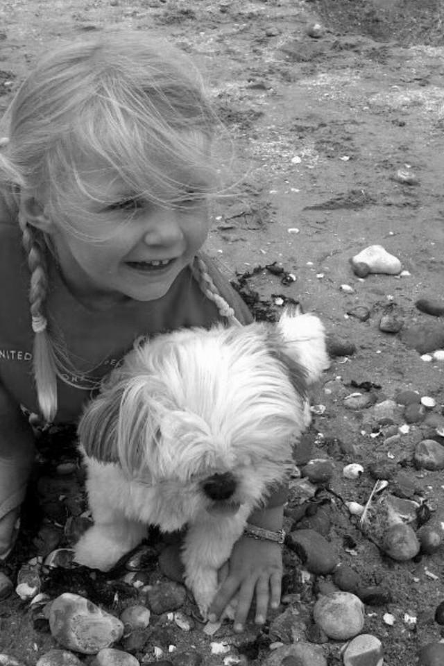 Little blond girl with her dog