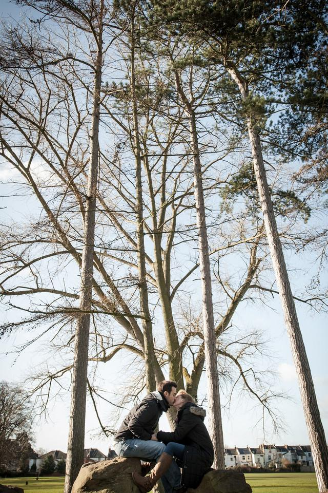 Couple kissing under trees