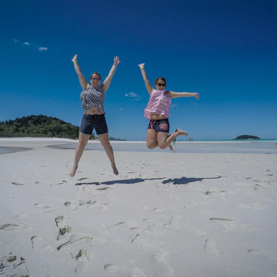Two girl jumping on the beach