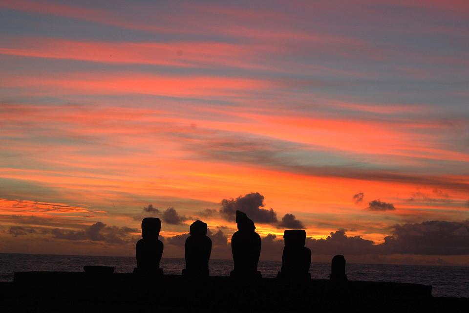 5 stones in front of a red-colored sky