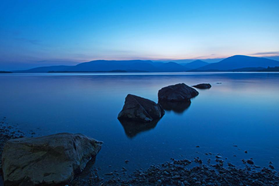 Blue colored image of a lake