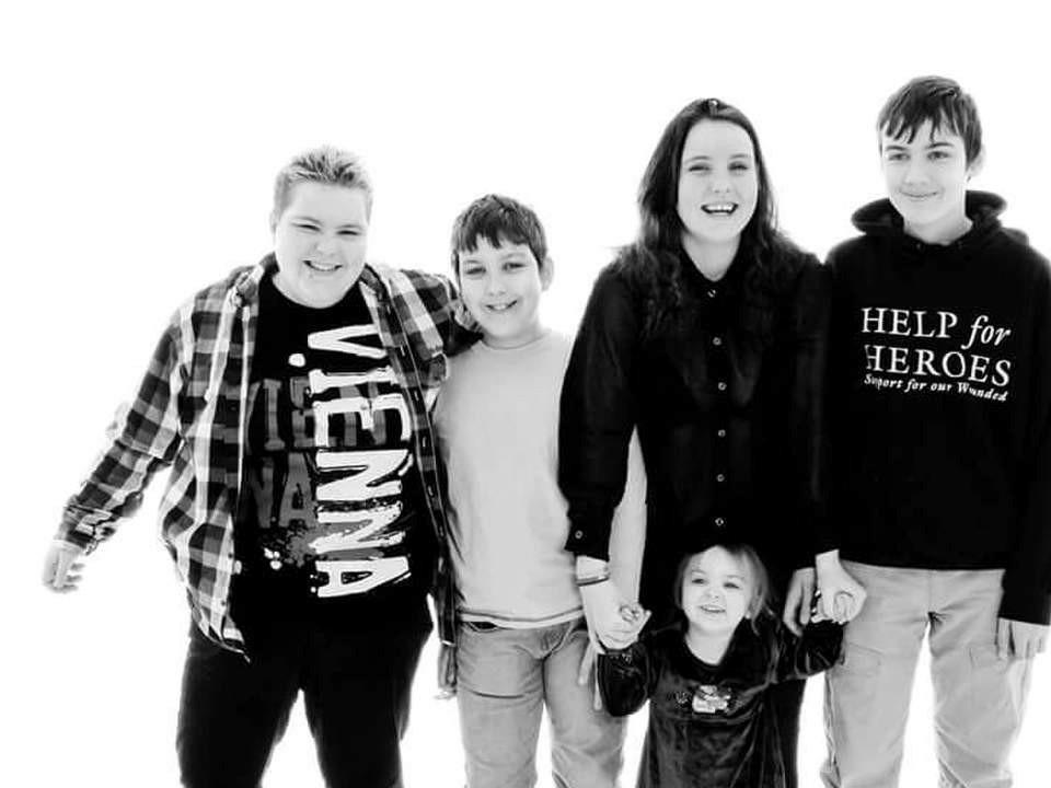black and white photo with 5 kids
