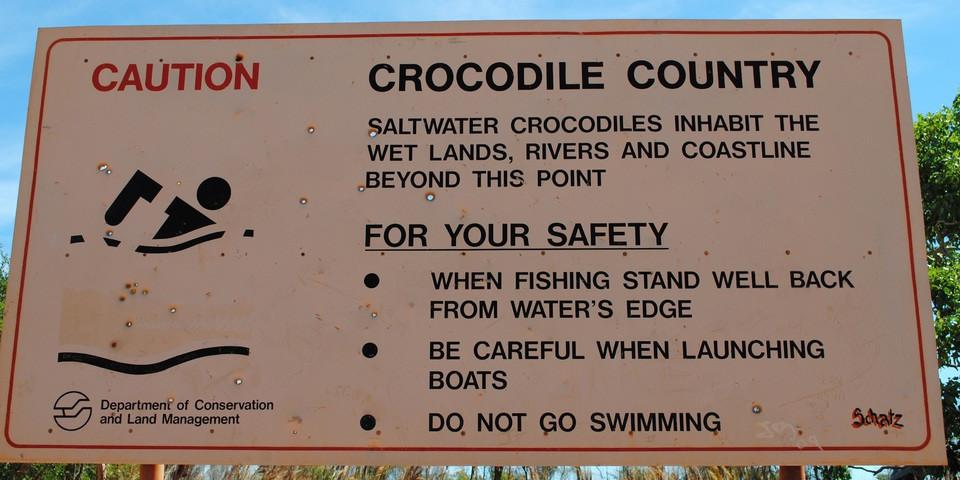 sign with warning for swimmers