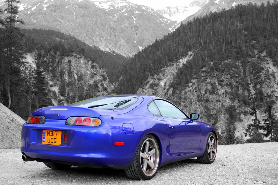 Car in front of mountains